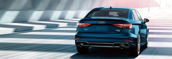 2019 Audi A3 in blue driving down a city street